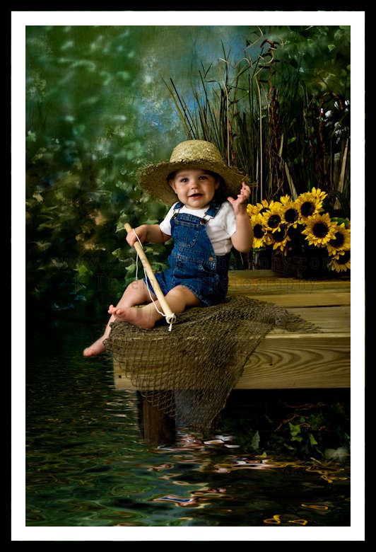 Toddler Boy with fishing pole, straw hat, on pier