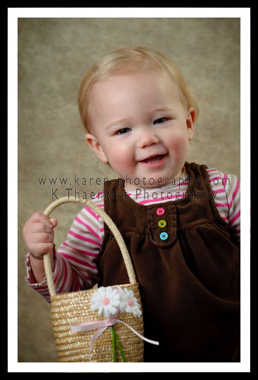 Photo of little 1 year old girl with a basket